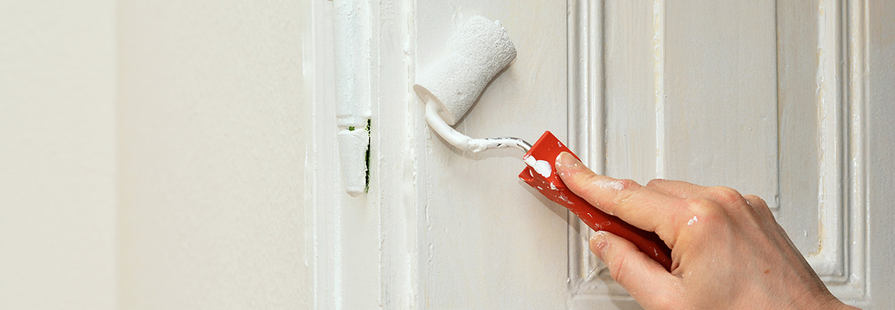 painting a door with a roller